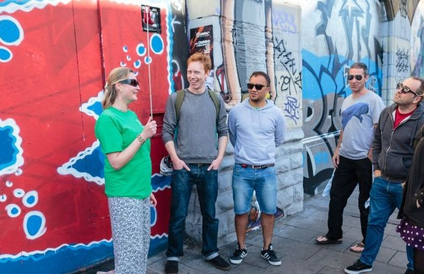 heather-laughing-with-tour-participants-in-front-of-bristol-street-art-2.jpg